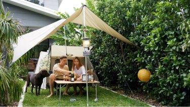 Eugen Schledewitz and Kelly Bang camped in their backyard in Salisbury, in Brisbane's south.