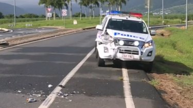 The Queensland police car rammed during the chase in Cairns on Sunday.
