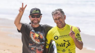 Narrow escape: Urunga surfer Matt Gallagher (right).
