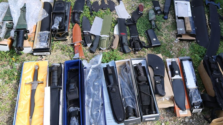 More than 100 knives and swords were found.