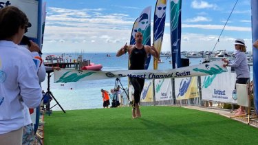 Sam Sheppard was the first male solo swimmer to cross the line at this year's Rottnest Channel Swim, finishing the race in 4 hours, 11 minutes and 22 seconds.