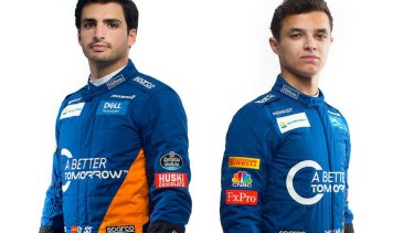 McLaren drivers Carlos Sainz and Lando Norris in racegear with the 'A Better Tomorrow' slogan