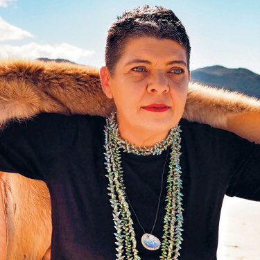 """""""I would love to walk into government as a full cultural black woman, but they need me to speak a language they know,"""" says Dr Emma Lee, pictured at Sisters Beach in north-west Tasmania."""
