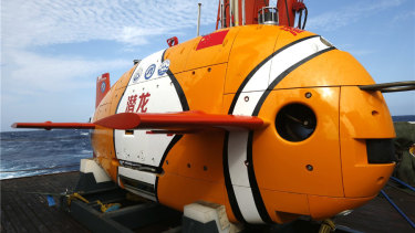China's newest unmanned submarine drone, Qianglong 3, after its first deep dive – 3500 metres into the South China Sea. Painted like a clownfish, it is designed to explore for resources on the sea floor.