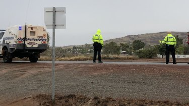 Police patrolling closed roads on Saturday.