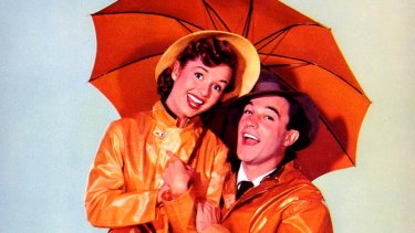 Debbie Reynolds and Gene Kelly star in the iconic film Singing in the Rain.