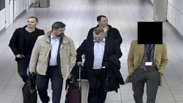 Four Russian officers are escorted to their flight after being expelled from the Netherlands on April 13, 2018, for allegedly trying to hack into the chemical watchdog OPCW's network.