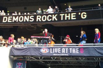 David Bridie singing at the MCG before a Melbourne game.