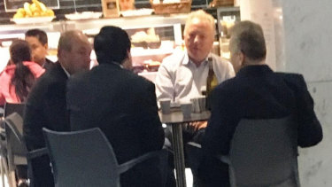 Daryl Maguire, left, with Charbel Demian, (second from left with back to camera), an unknown male referred to as Ron (white shirt) and Michael Hawatt (right, back to camera) at a Sydney café.