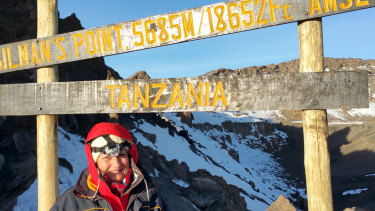 Louise Di Francesco at the top of Mount Kilimanjaro.