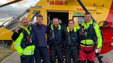 Mr Bowman pictured with rescue crews on Tuesday afternoon.