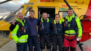 Michael Bowman, 57, is pictured with rescue crews on Tuesday afternoon.