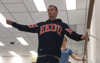 Garside performs ballet exercises as part of his preparation for the Olympics.
