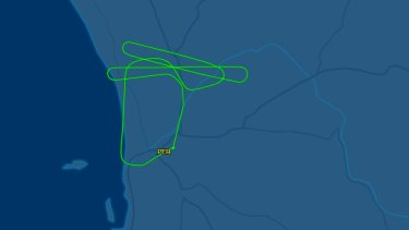 The flight returned to Perth Airport just under an hour after takeoff because of an in-flight engine shutdown.