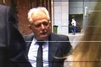 Developer John Woodman leaves the IBAC hearing.