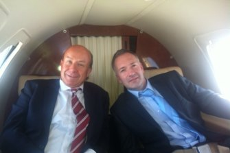 Former NewSat CEO Adrian Ballintine in a corporate jet with the then chief financial officer of his yacht company, Jason Cullen.