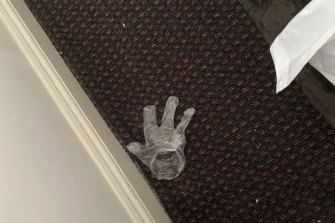 A discarded glove Mr de Kretser found on the floor of his dirty hotel room.