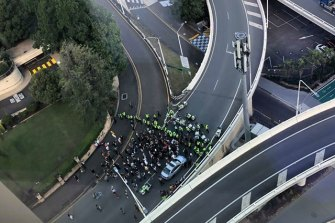 Queensland police form a barricade to keep protesters away from traffic.