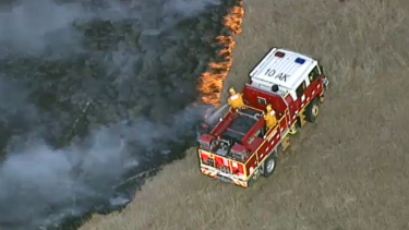 Emergency services are at the scene of a grassfire in Mernda.