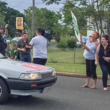 """The """"Stop Adani"""" convoy was greeted with disdain when it arrived in the Queensland mining town of Clermont."""