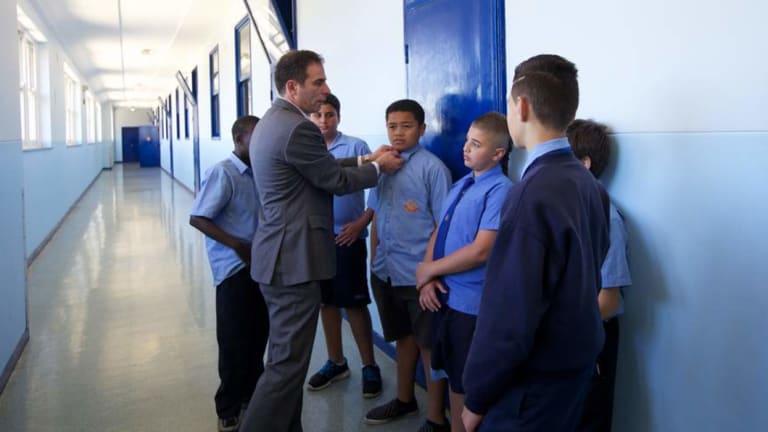 Principal Jihad Dib inspects the uniform of students at Punchbowl Boys'.