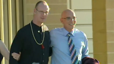 Andrew Mallard leaves prison with John Quigley.