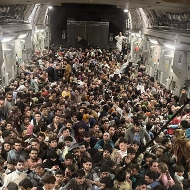 Afghans packed inside a US Air Force C-17 Globemaster III at Kabul airport on Sunday night.