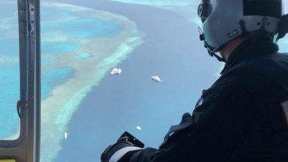 Shark bites man on leg at popular Great Barrier Reef dive spot