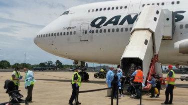 Passengers leave the flight.