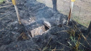 Fire damage at the Telstra cable pit east of Orange.