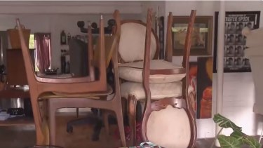 Robby Cenda, who lives on the Tweed River, has tried to save his furniture and belongings from water damage.