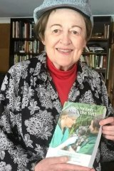 Helen Jones Fairnie with a copy of She's No Lady – She's the Vet! Stories from 100 years of female vets in Australia.