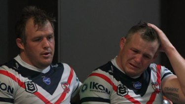 Inconsolable: Brett Morris with brother Josh in the rooms after the Knights match.