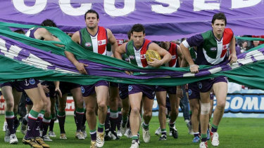Josh Carr (centre) in his playing days for Fremantle with Justin Longmuir (right). The two have been reunited at the Dockers as coaches.