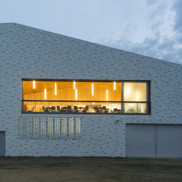 Pipi shells inspired Neeson's design for the outside of the Kempsey-Crescent Head SLSC, which she overhauled in 2015.