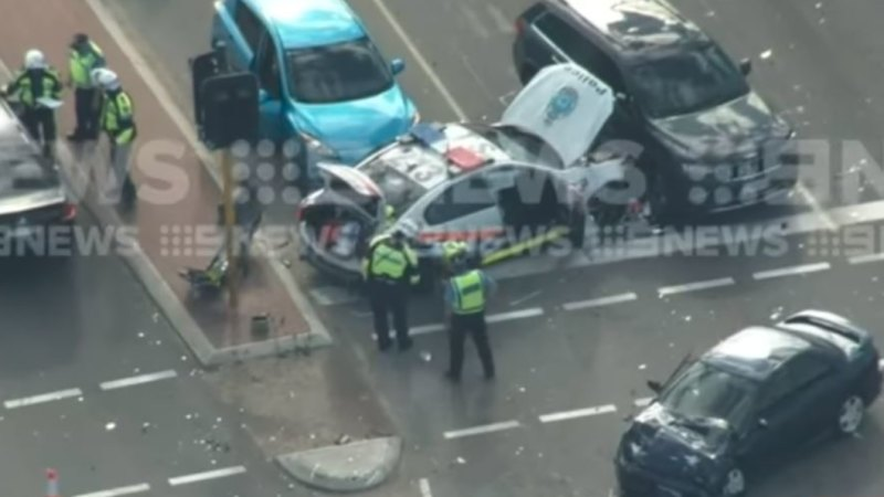 Two police officers hospitalised after car crash in Perth's