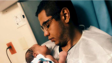 Andre Anchondo, who was killed on Saturday in the El Paso shooting, is pictured here with his newborn.