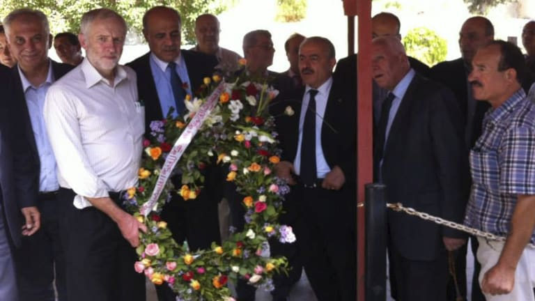 Jeremy Corbyn is shown at a wreath laying ceremony in a Tunisian graveyard that has led to accusations he was honouring terrorists.