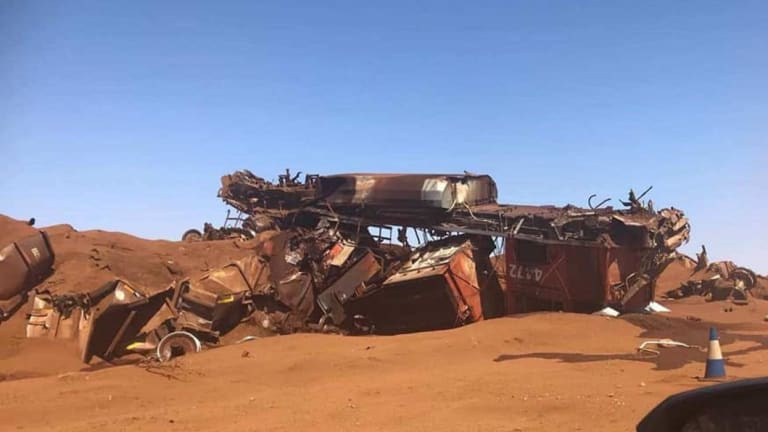 The crash turned the train and its wagons into a mess of crumpled metal and spilled iron ore.
