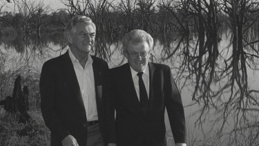 Bob Hawke and Graham Richardson walk among dead box trees at Disher Creek in Renmark South Australia.