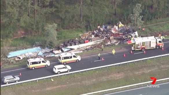 Man trapped after truck tips off Bruce Highway