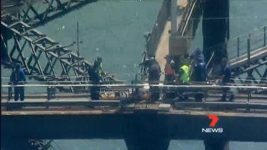 A woman was evacuated from the top of the Harbour Bridge after suffering heat exhaustion.