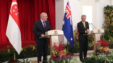 Scott Morrison meets his Singapore counterpart Lee Hsien Loong at a stopover on the way to the G7 in Britain.
