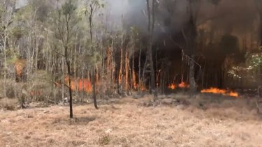 The bushfire at Woodgate, south of Bundaberg has been escalating on Friday as firefighters battle the blaze.