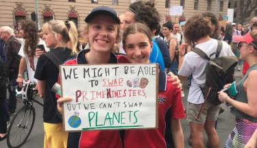 """We might be able to change PMs, but we can't change planets."" Zoe and Gemma, 13, at Friday's rally."