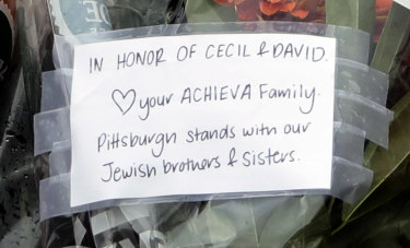 A note honours shooting victims Cecil and David Rosenthal.