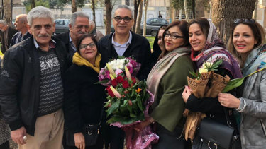 Afif Naeimi, centre, and his loved ones in Tehran shortly after his release.