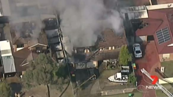 Firefighters battle south-west Sydney blaze after three homes catch alight