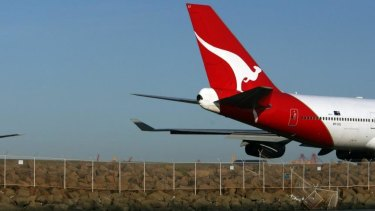 Two Qantas flights were in a near miss in Perth on Saturday.