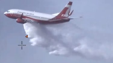 The NSW Rural Fire Service large air tanker is also flying across the border to attack the flames from above.